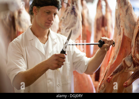 Butcher sharpening knife - Stock Photo