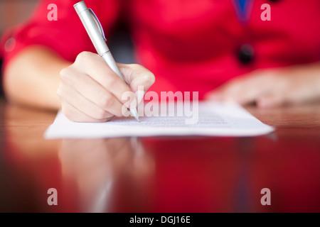Woman writing, close up - Stock Photo