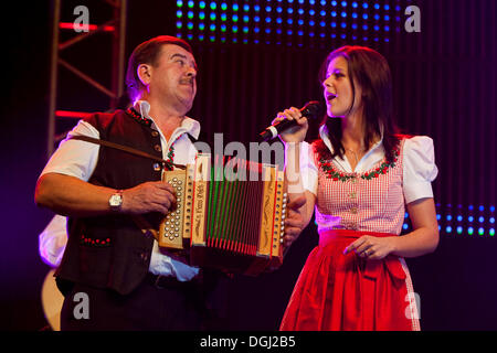 Swiss folk music and pop group Oesch's die Dritten performing live at the 10th Schlager-Night in the new Allmend - Stock Photo
