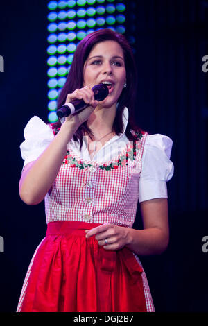 Melanie Oesch from the Swiss folk music and pop group Oesch's die Dritten performing live at the 10th Schlager-Night - Stock Photo