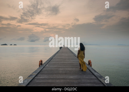 Woman on pier, Taling Ngam Beach, Ko Samui, Thailand - Stock Photo