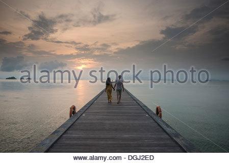 Couple on pier, Taling Ngam Beach, Ko Samui, Thailand - Stock Photo