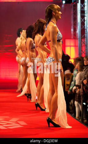 Young women presenting themselves in a bikini at the Miss Central Switzerland Show 2011 in RailCity, Luzern railway - Stock Photo