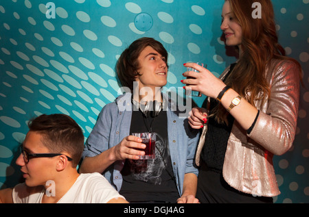 Teenagers holding drinking glasses - Stock Photo