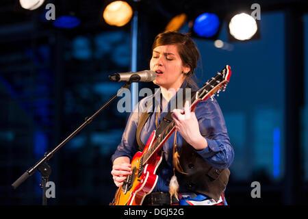 The British folk singer Charlene Soraia playing live outside the KKL Plaza at the Blue Balls Festival, Lucerne, - Stock Photo