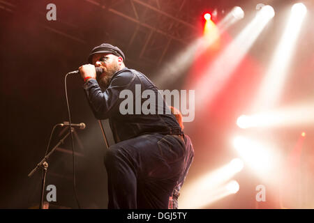 Singer and frontman Tony Sylvester from the Norwegian heavy metal, rock and punk band Turbonegro performing live - Stock Photo
