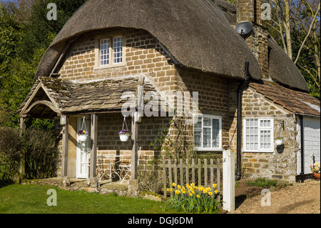 Small thatched cottage in rural Wiltshire UK - Stock Photo