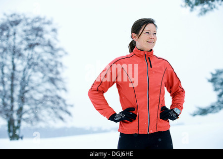 Close up of woman standing in snow field - Stock Photo