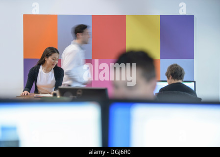 Architects working in busy office, blurred motion - Stock Photo