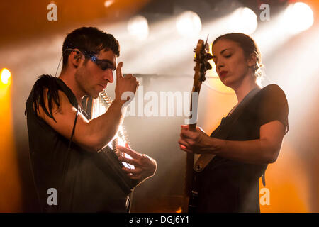Singer Thom Luz and bassist Betty Fischer from the Swiss indie rock band My Heart Belongs To Cecilia Winter performing - Stock Photo