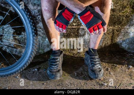 A male mountain biker resting. - Stock Photo