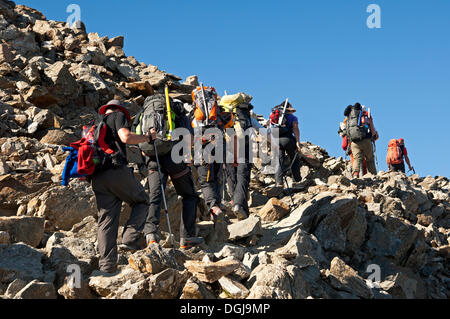 Alpinists during the ascent of Mont Blanc along the regular route via Gouter Hut, Chamonix, Haute Savoie, France, - Stock Photo
