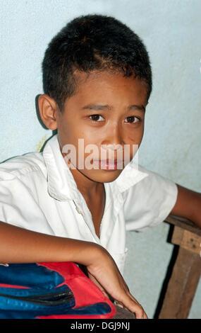 Portrait of a school boy, primary school in the village of Areyskat near Phnom Penh, Cambodia, Southeast Asia - Stock Photo