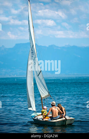 Family trip on a sail boat on Lake Geneva near Morges, Vaud Alps at back, Alpes vaudoises, Canton of Vaud, Switzerland, - Stock Photo