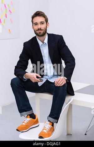 Portrait of young male in design studio - Stock Photo