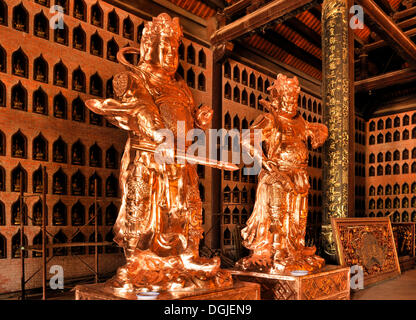 Restored statues on the construction site of the Chua Bai Dinh pagoda, one of the largest pagodas in Southeast Asia - Stock Photo