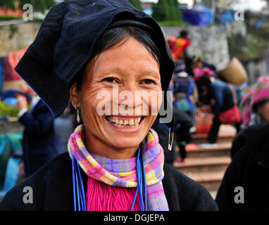 Woman from the Black Hmong ethnic minority group at the market of Sapa or Sa Pa, northern Vietnam, Vietnam, Asia - Stock Photo