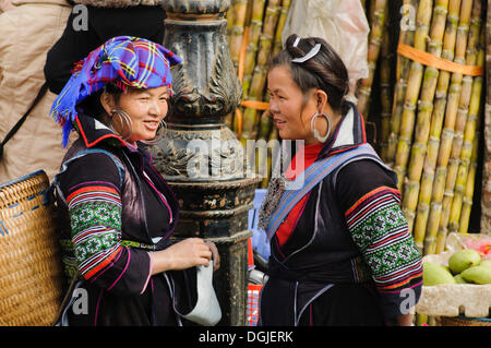 Two women at the market in Sapa or Sa Pa, Black Hmong ethnic group, ethnic minority, northern Vietnam, Vietnam, - Stock Photo