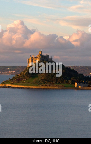 St Michael's Mount sunrise clouds background and Mount Bay & sea in foreground Marizion Penzance Cornwall Lands - Stock Photo
