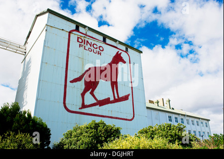 The Dingo Flour sign on the side of the Great Southern Roller Flour Mills in Fremantle in Western Australia. - Stock Photo