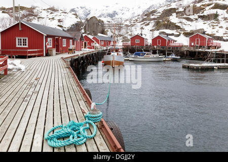 Small harbour with red fishermen's huts in winter, A, Lofoten, Nordland, Northern Norway, Norway - Stock Photo