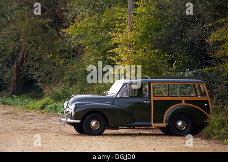 Morris Minor 1000 traveller classic British estate car parked in car park at Buckler's Hard in October - Stock Photo