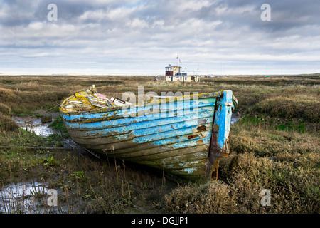The remains of an old wooden dinghy abandoned in the Tollesbury Saltings. - Stock Photo