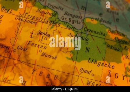 Libya, crisis region, illuminated old globe, map section - Stock Photo