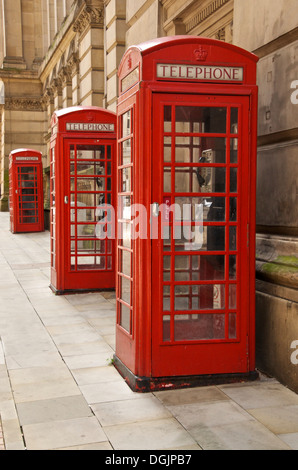 Three old style K6 red telephone boxes in Eden Place Birmingham UK - Stock Photo