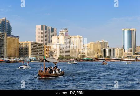 Water taxi, ABRA, dhow on the Dubai Creek between the Bur Dubai and Deira districts, Dubai, United Arab Emirates, - Stock Photo