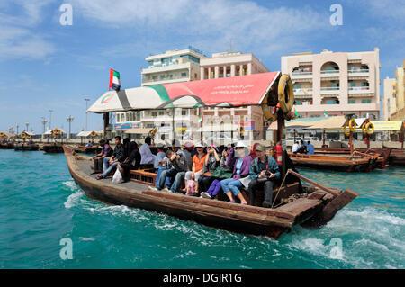 Water taxis, Abra, dhow on Dubai Creek, Dubai, United Arab Emirates, Middle East - Stock Photo