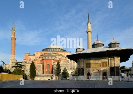 Fountain of Ahmed III and Hagia Sophia, Ayasofya, UNESCO World Cultural Heritage Site, Istanbul, European side - Stock Photo