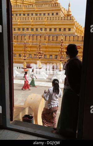 Scene through a doorway at Shwezigon Pagoda in Bagan in Myanmar. - Stock Photo