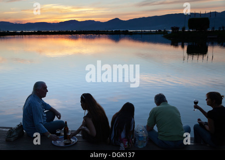 A nice drink and snack at sunset on the Lake Inle Resort in Myanmar. - Stock Photo