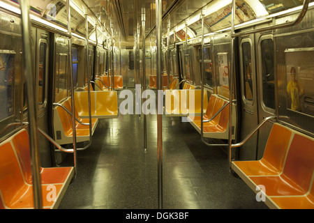Empty subway car on the F Train in Brooklyn, NY. - Stock Photo