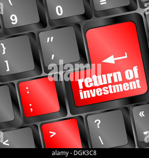 invest or investing concepts, with a message on enter key or keyboard - Stock Photo