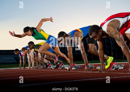 False start in race, woman running against men - Stock Photo