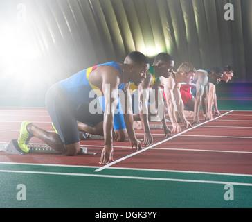 Athletes on start line of race - Stock Photo