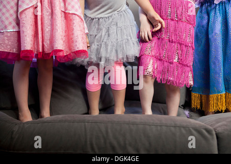 Children standing on sofa - Stock Photo