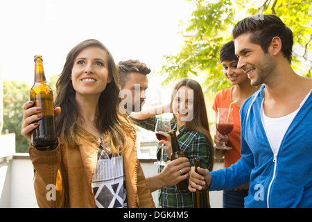 Friends drinking beer outdoors Stock Photo, Royalty Free ...