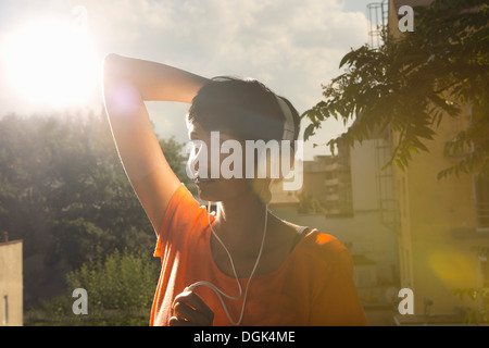 Woman wearing headphones - Stock Photo