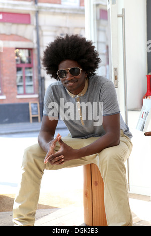 Mature man with afro hair wearing sunglasses - Stock Photo