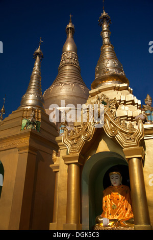 The spires and stupas and pagodas of the Shwedagon Temple Complex in Yangon in Myanmar. - Stock Photo