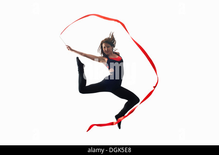 Dancer with ribbon on white background - Stock Photo