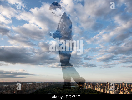 Double exposure of businessman against cityscape - Stock Photo