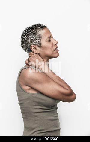 Senior woman with neck pain - Stock Photo