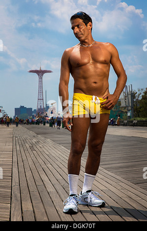Portrait of man in yellow trunks, Brooklyn, New York, USA - Stock Photo