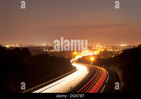 Traffic on road at night in Toulouse, France - Stock Photo