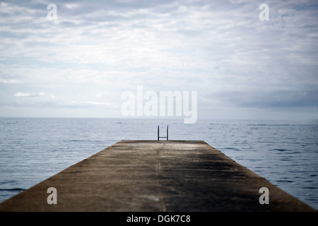Jetty going into the ocean - Stock Photo