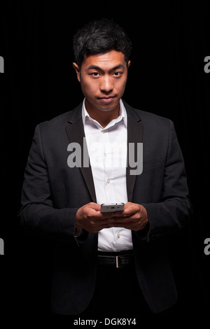 Businessman using smartphone - Stock Photo